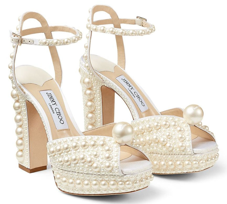 The Jimmy Choo Sacaria embraces maximalist glamour with all-over pearl embellishments