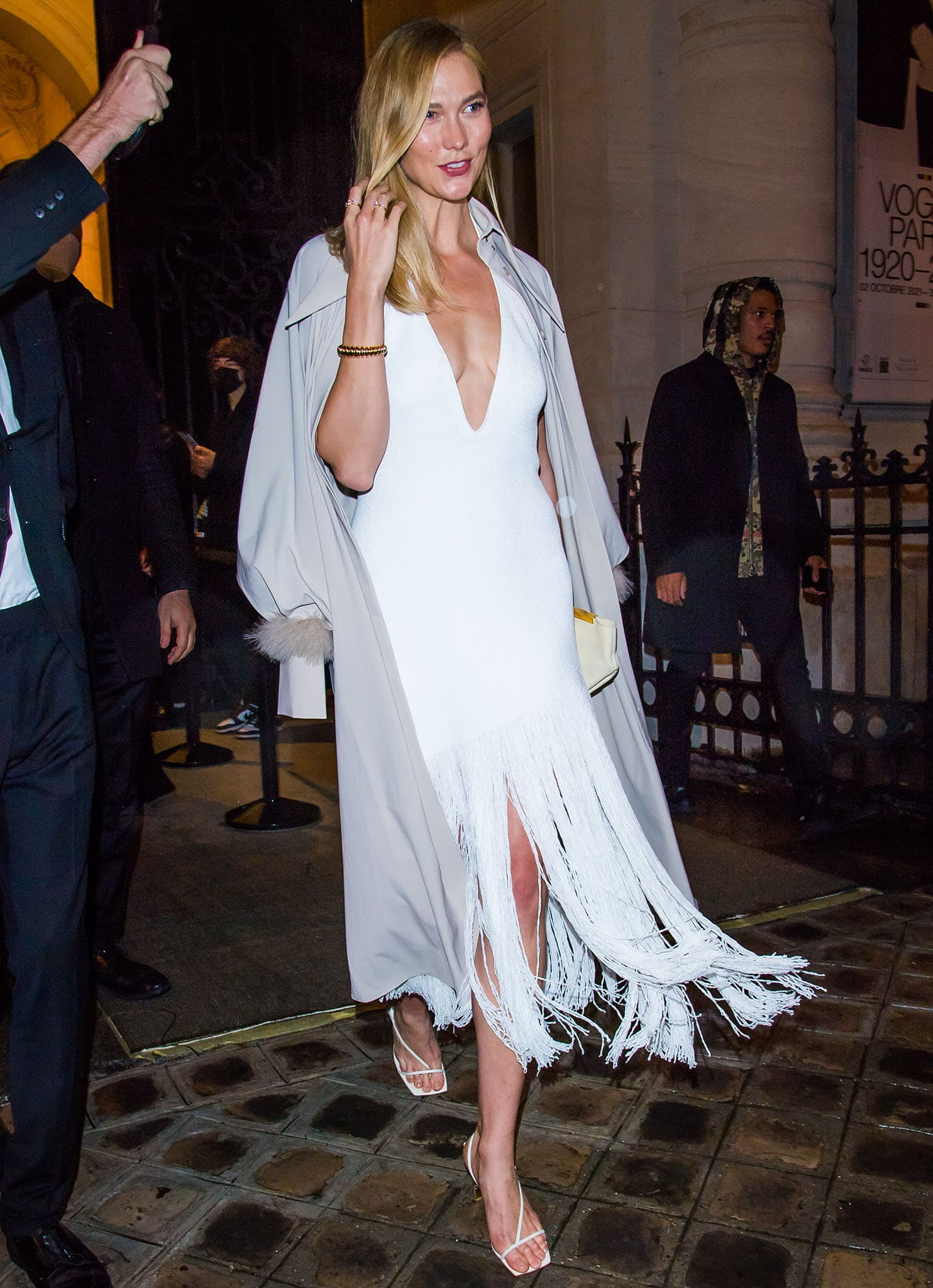 Karlie Kloss highlights her cleavage at the Vogue Paris 100th Anniversary exhibition party