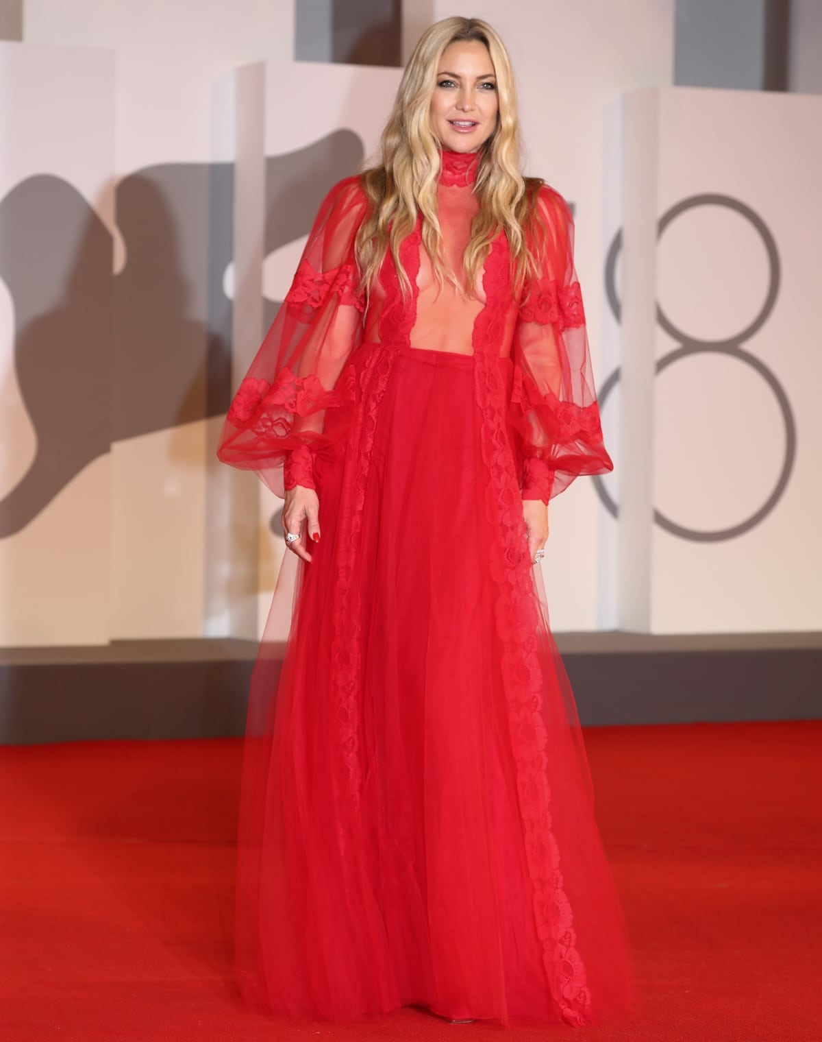 Kate Hudson in a red Valentino Resort 2022 gown at the premiere of Mona Lisa And The Blood Moon