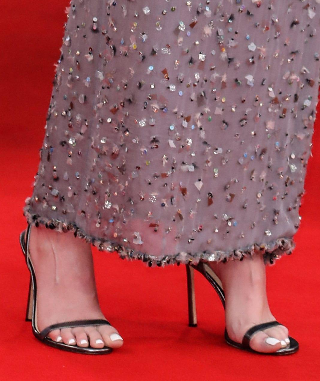 Kristen Stewart shows off her white pedicure in minimalist Jimmy Choo Minny sandals