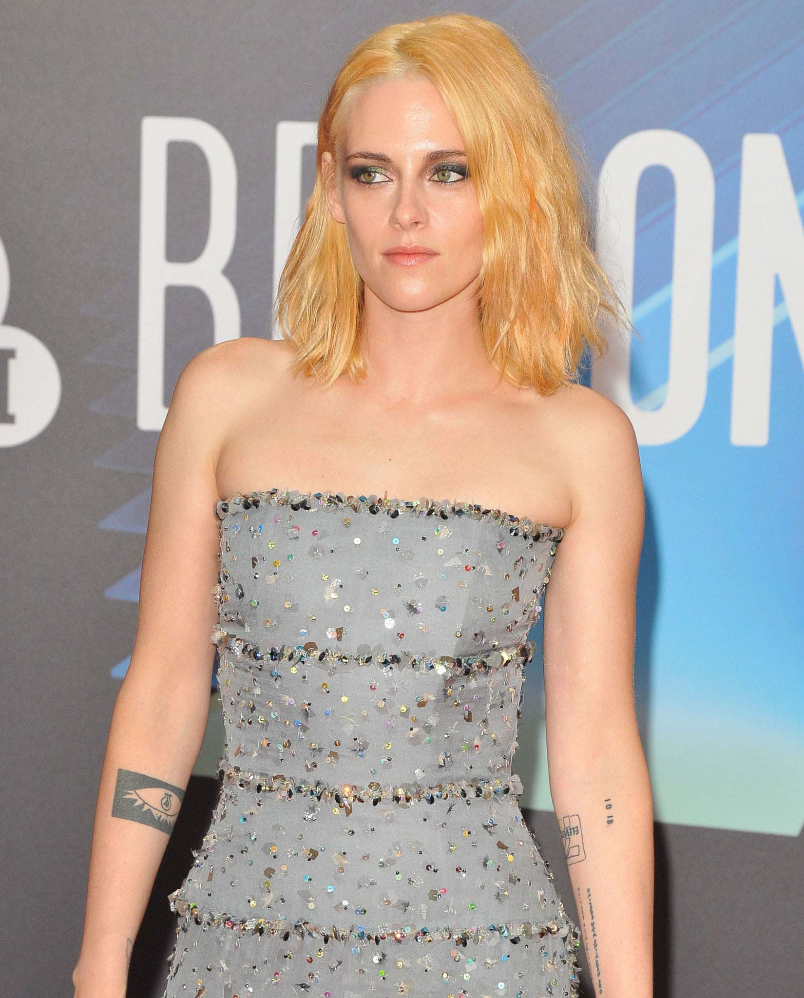 Kristen Stewart continues the glamour with beach waves lob hairstyle and smokey eye-makeup
