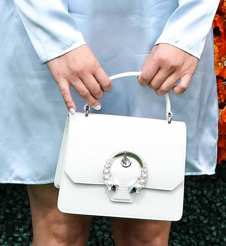 Lana Condor carries a white Jimmy Choo Madeline satchel with pearl and crystal embellishments