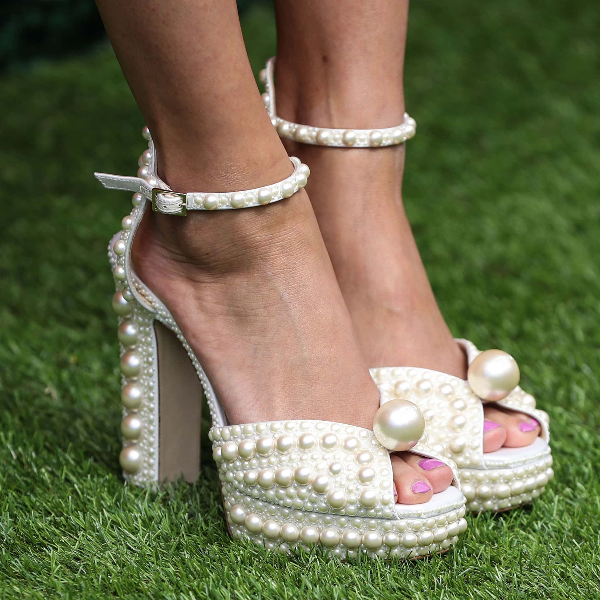 Lana Condor shows off her pink pedicure and pretty feet in Jimmy Choo's Sacaria pearl-embellished platform sandals