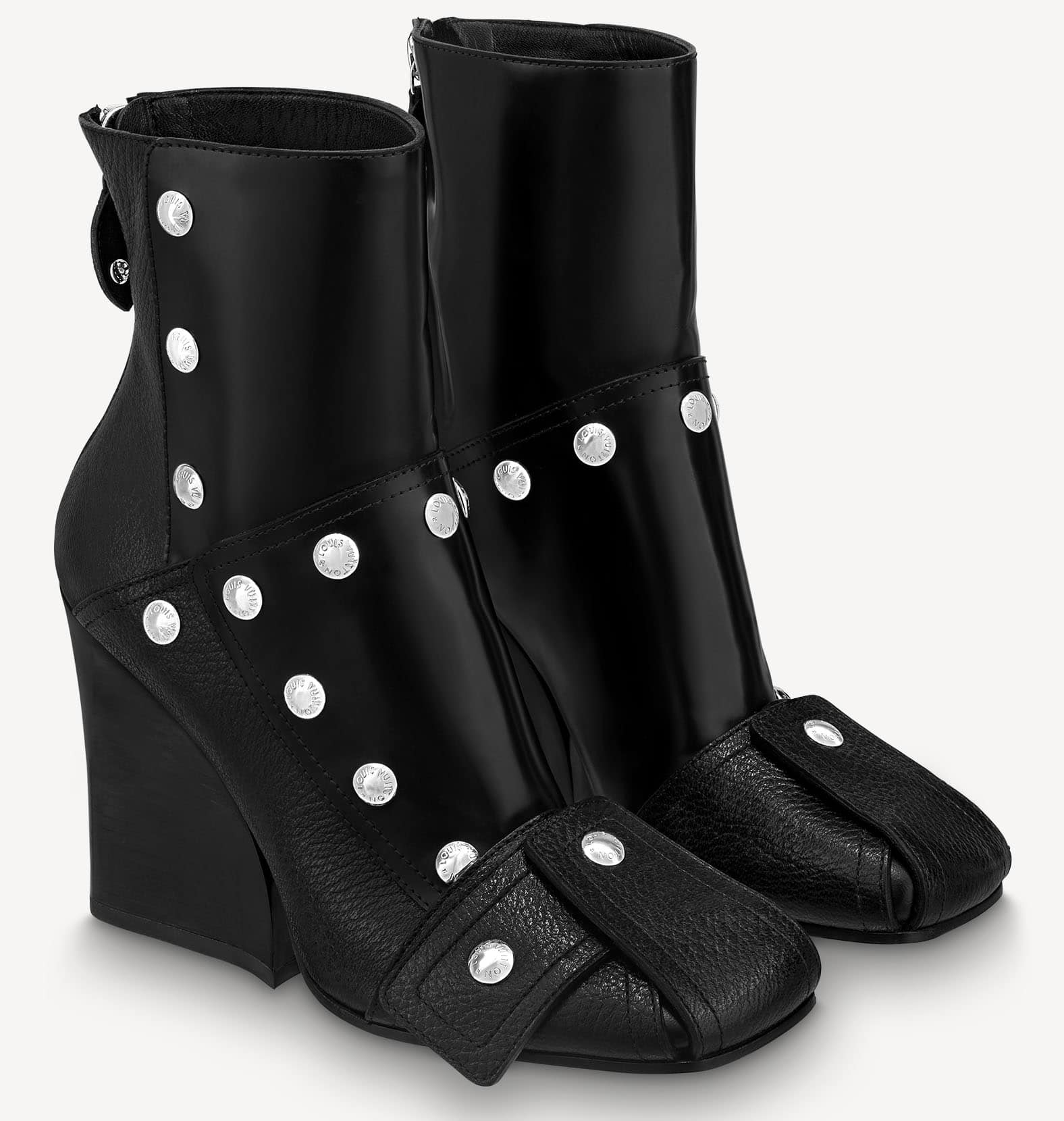 Louis Vuitton's Patti wedge boots feature a contemporary silhouette with engraved silver studs, square toes, and high wedge heels