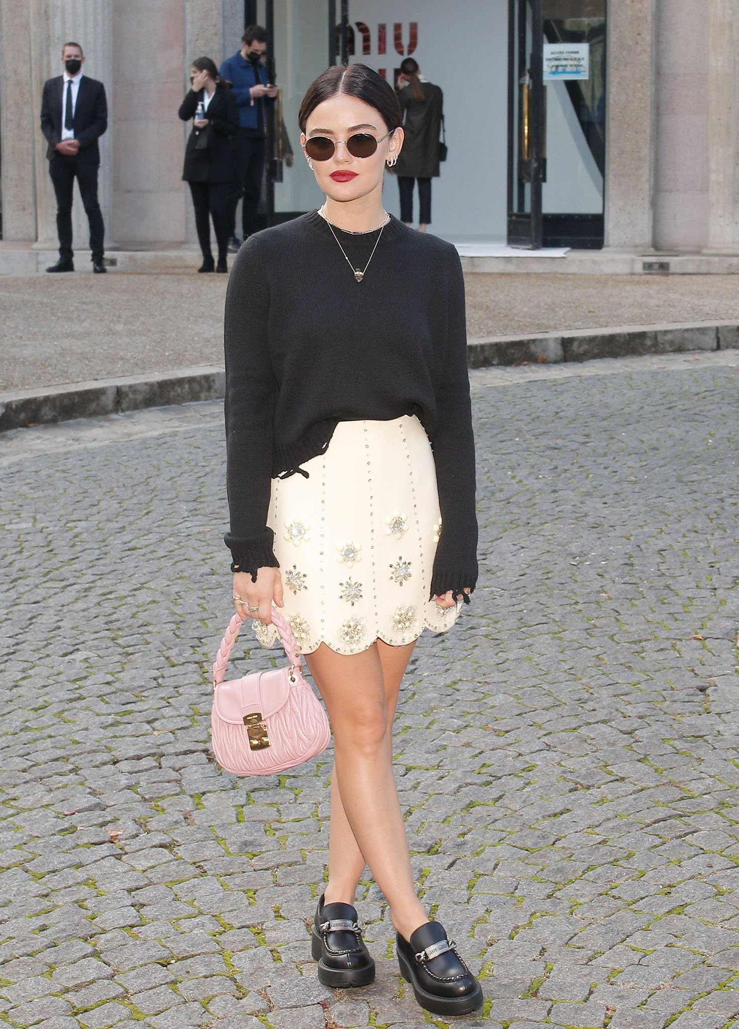 Lucy Hale attends Miu Miu's fashion show during Paris Fashion Week on October 5, 2021