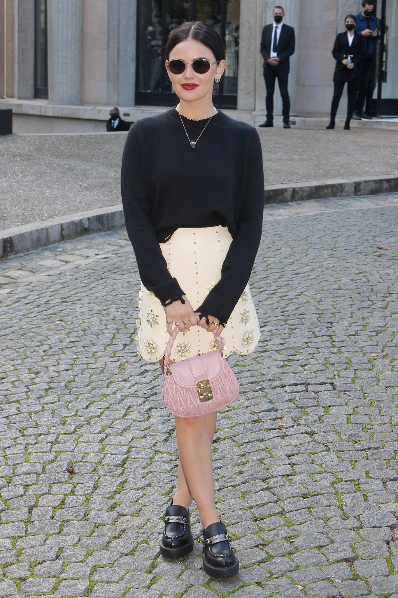 Lucy Hale shows off her legs in a Miu Miu embellished mini skirt and a distressed sweater
