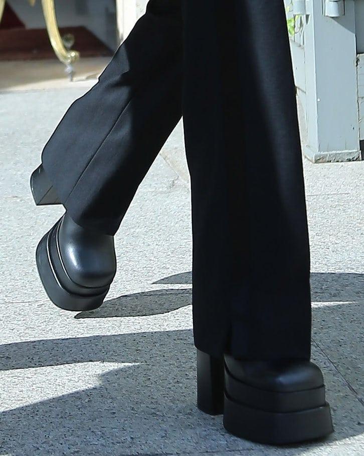 Nicola Peltz boosts her height with Versace block-heel platform boots