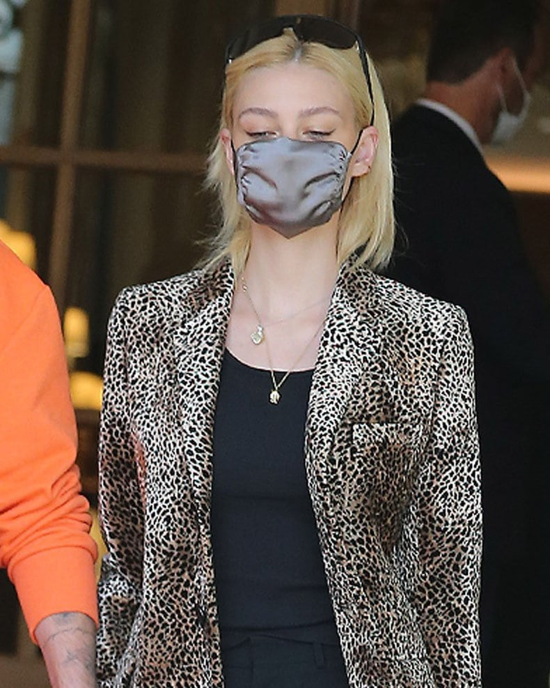 Nicola Peltz steps out with minimal makeup and wears her sunglasses over her head