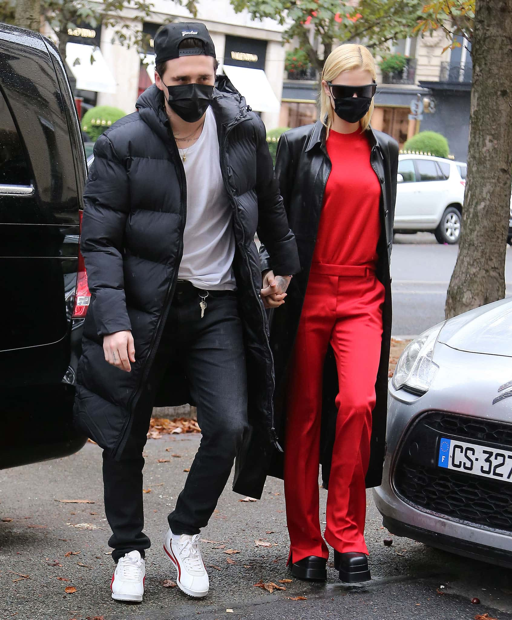 Nicola Peltz holds fiancé Brooklyn Beckham's hand while clad in coordinating red top and pants in Paris on October 1, 2021