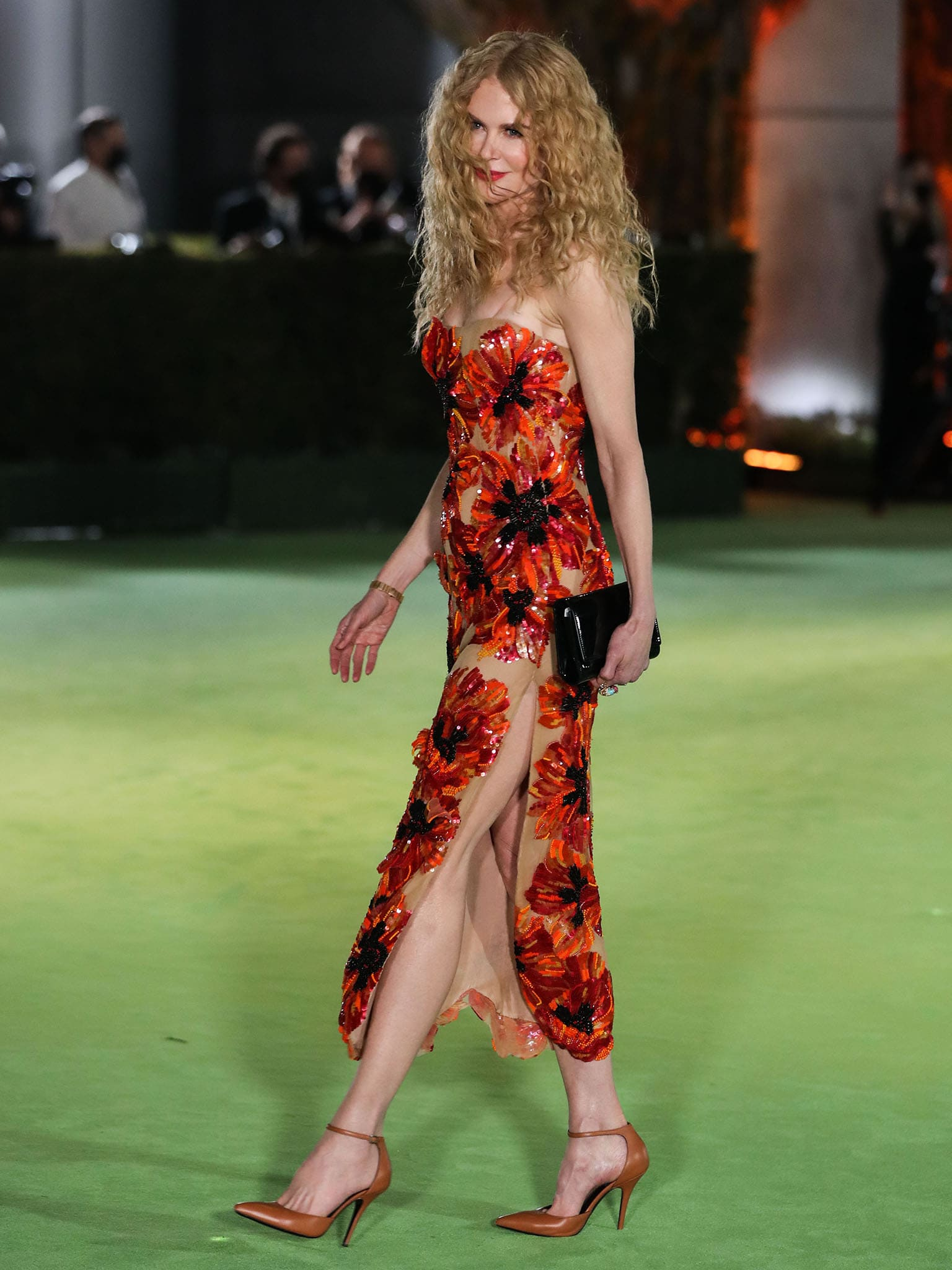 Nicole Kidman showcases her slim figure and slender legs in a hand-beaded red floral dress from Rodarte
