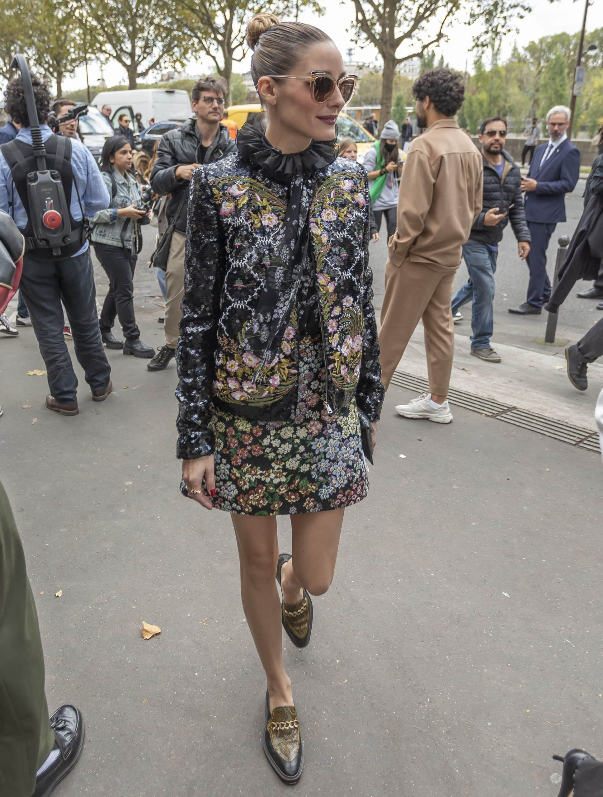 Olivia Palermo shows off her legs in a Giambattista Valli Fall 2021 floral jacquard mini skirt and jacket