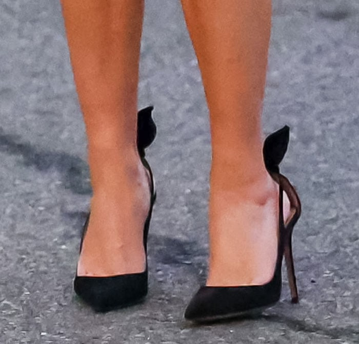 Reese Witherspoon pairs her mini dress with Aquazzura black heels
