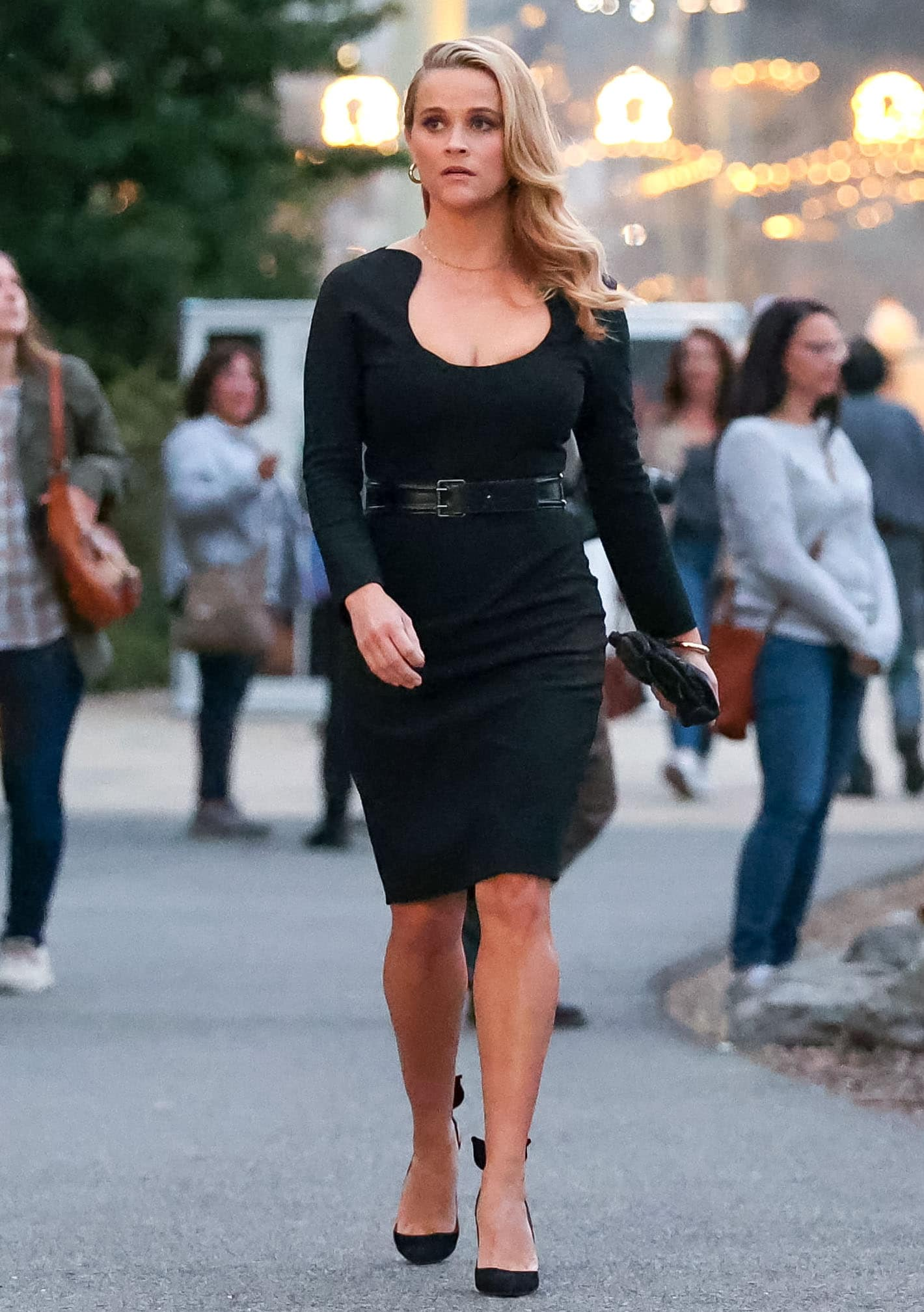 Reese Witherspoon showcases her curves in a form-fitting black body-con dress on the set of her new movie
