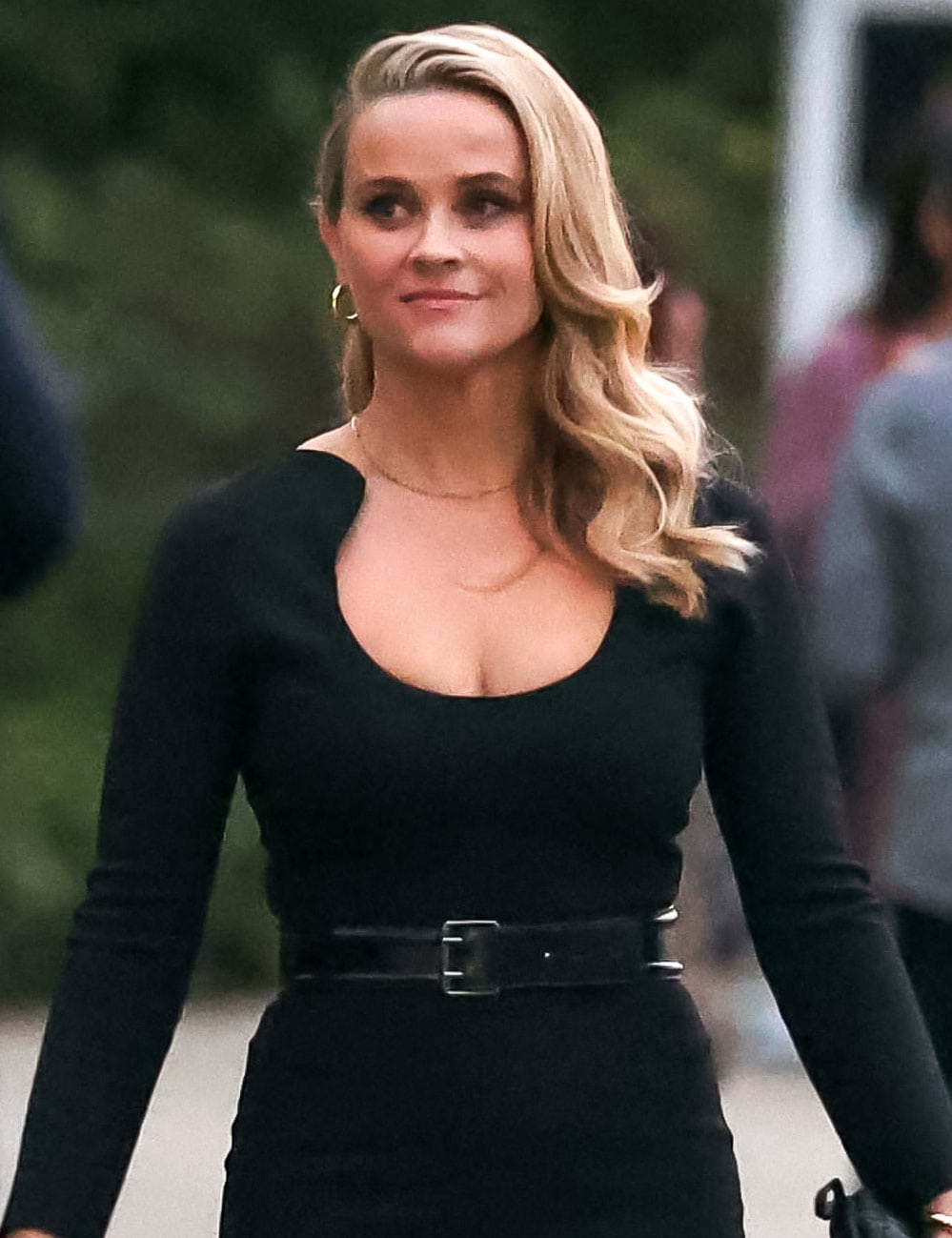 Reese Witherspoon wears neutral makeup and styles her hair in Old Hollywood curls with a deep side parting