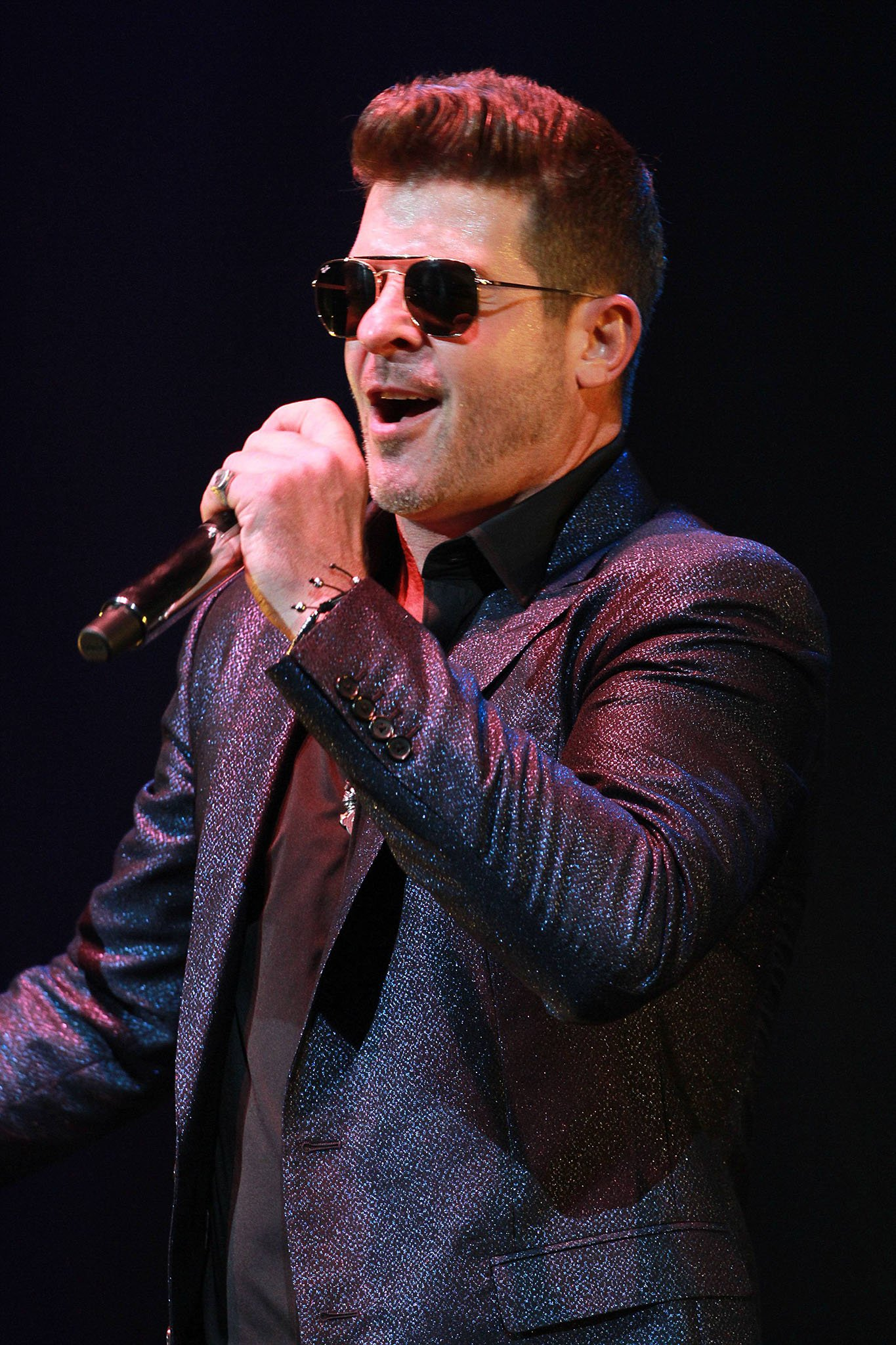 Robin Thicke, pictured performing at the 2019 Sketchbook Tour, is accused of groping Emily Ratajkowski's boobs