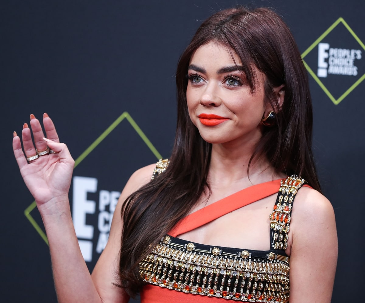 Pictured in Fausto Puglisi at the 2019 E! People's Choice Awards, Sarah Hyland got her third COVID vaccine booster shot in September 2021