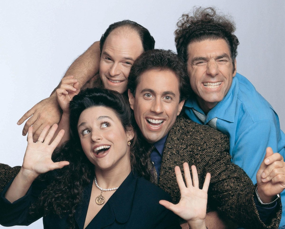 Jerry Seinfeld as a fictionalized version of himself, George Costanza (Jason Alexander), Jerry's former girlfriend Elaine Benes (Julia Louis-Dreyfus), and neighbor across the hall Cosmo Kramer (Michael Richards) in the American sitcom television series Seinfeld