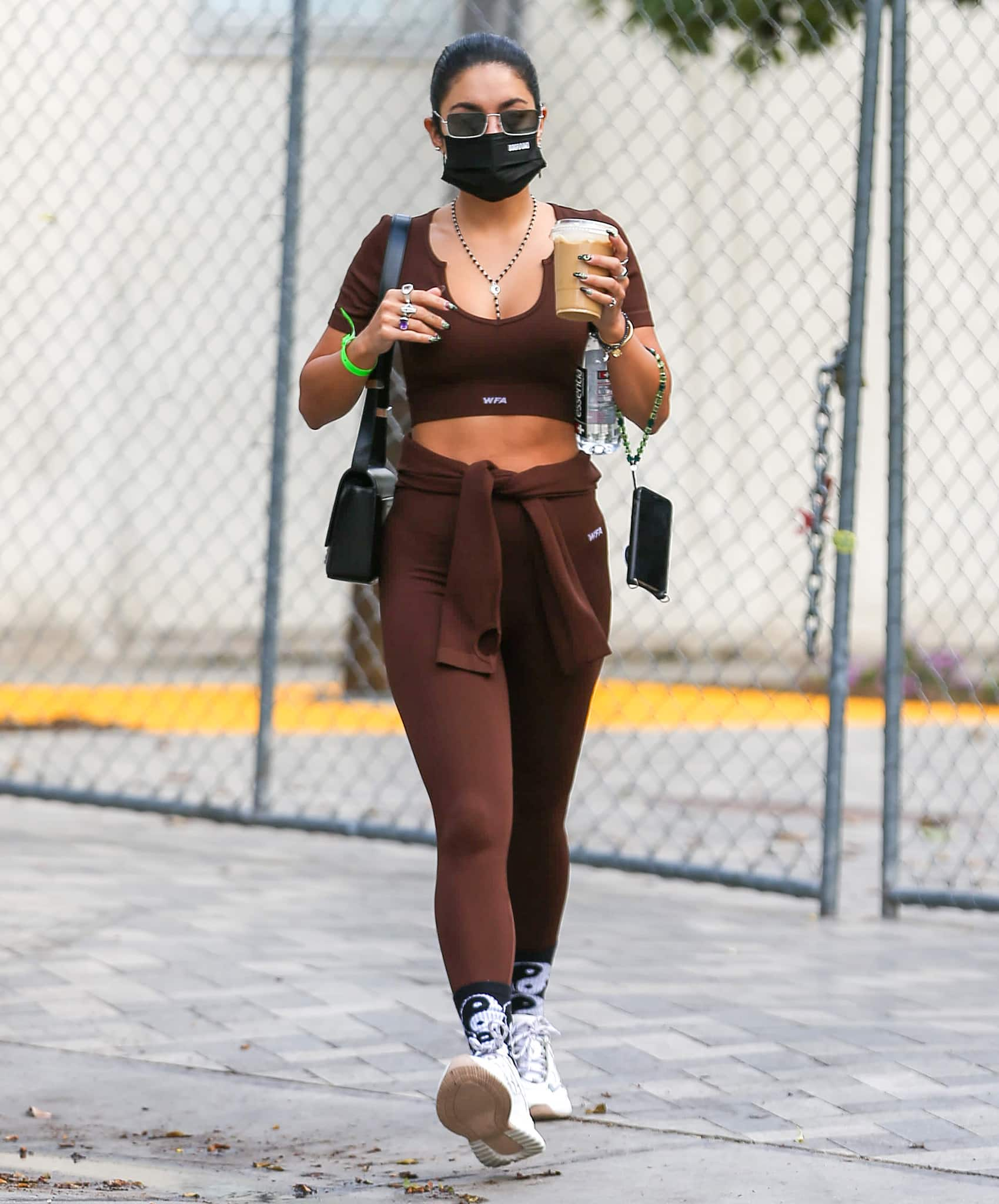 Vanessa Hudgens flaunts her abs in a brown White Fox Boutique crop top and leggings