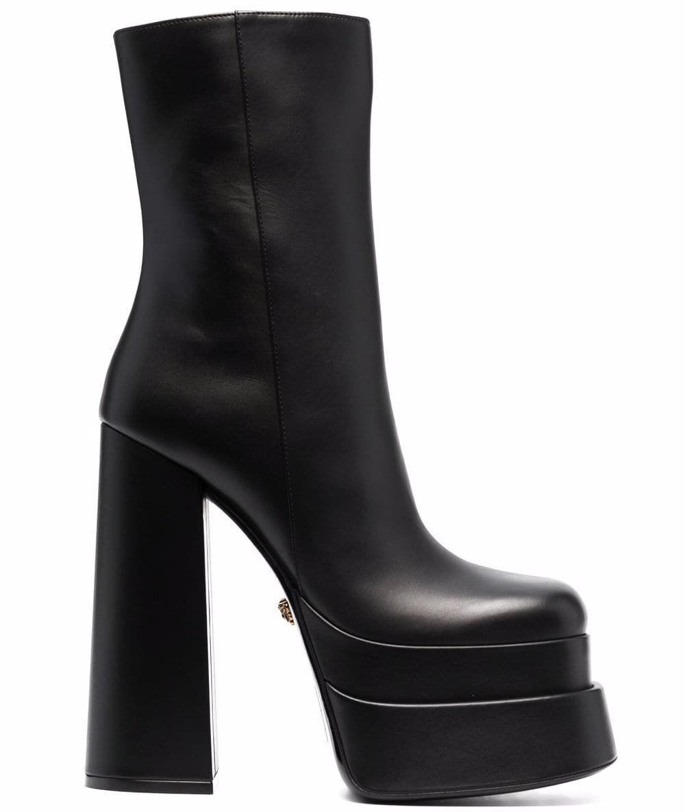 Versace's leather boots feature towering block heels and chunky platforms with contemporary square toes